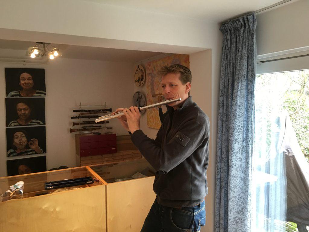 The dutch flutist Han Litz; checking his flute after overhaul